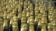 A machine processes hundreds of champagne bottles.
