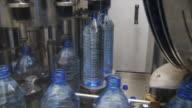 MS Machine rotating full plastic water bottles and placing them on conveyor / Wau, Western Bahr el Ghazal, Sudan