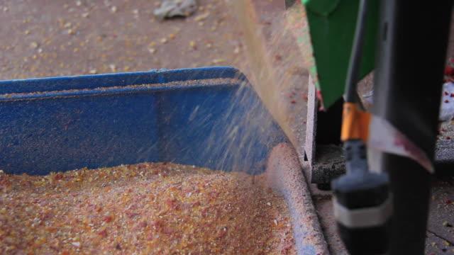 MS Machine triturating ingredients to make ration / Campo Grande, Mato Grosso do Sul, Brazil