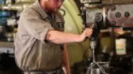 MS TU Machine Worker Using Drill Press in Machine Shop