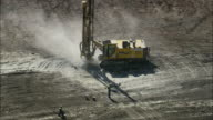 AERIAL WS Machinery drilling at quarry, Bethanie, North West, South Africa