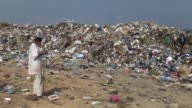 Machines work at a trash collection area in the north of Gaza City Gaza on September 11 2015 It has been announced that poorly constructed refuse...