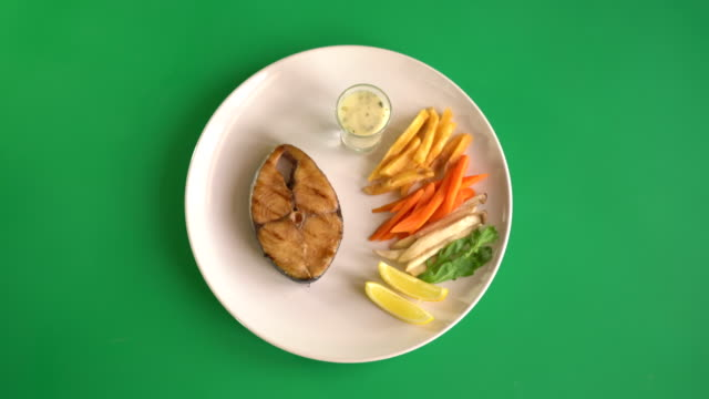 mackerel fish steak on green screen