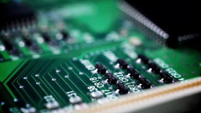 A macro computer circuit board is displayed.
