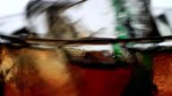 Macro Shot of Stirred Cola.