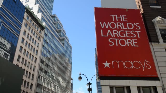 Macy's flagship store in New York NY US on February 24 Wide shot pan of The World's Largest Store Macys signage and pedestrians walking by Close up...