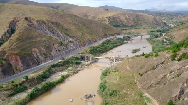Madagascar Highlands Dirty River Bridge Drone View
