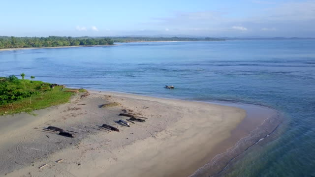 Madagascar Mahambo Tropical Coast with dugout canoe Drone View