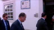 British detectives meet Portuguese police PORTUGAL Algarve Faro EXT British detectives along and into police station