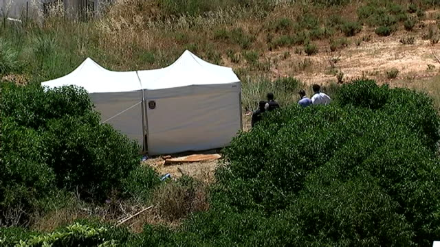 British police at search site View over apartments to coast and forensic tent towards blue sea / Various of police erecting incident tents and...