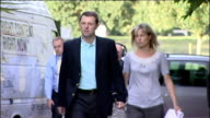 parents press conference on no longer being suspects EXT Kate and Gerry McCann arriving at press conference