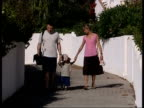 Madeleine McCann disappearance / Parents walk Madeleine's twin sisters to a creche PORTUGAL Algarve Praia da Luz EXT Various of Gerry and Kate McCann...