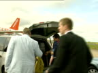 Gerry McCann statement on return to UK McCanns away to car with airport staff and David Hughes loading with luggage entering car and away past plane