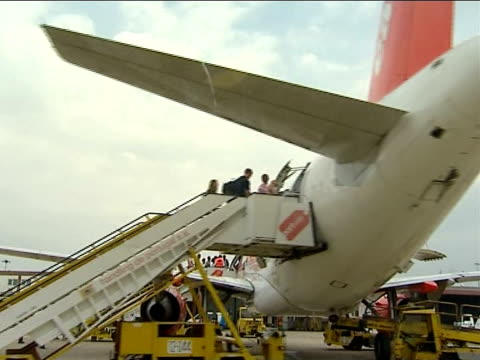McCann family boarding plane to return to UK PORTUGAL Faro Airport EXT People boarding EasyJet aircraft