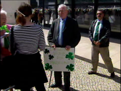 Madeleine McCann's parents go on pilgrimage to holy shrine Man standing in square holding placard 'Ireland prays for Madeline'