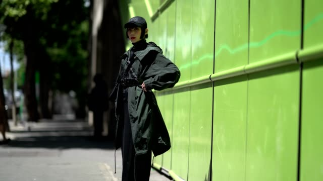Mademoiselle Yulia wears a cap a coat outside the Y3 show during Paris Fashion Week Menswear Spring/Summer 2018 on June 25 2017 in Paris France