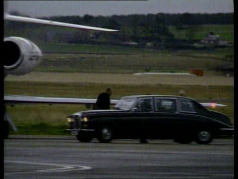 Stars arrive in Scotland for wedding ITN SCOTLAND Inverness Airport Pop singer Sting with wife Trudi Styler along from plane as arriving in Inverness...