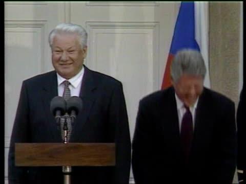 Money laundering LIB MAT HELD BUREAU President Bill Clinton Russian President Boris Yeltsin standing together on podium laughing SIDE CMS Clinton...
