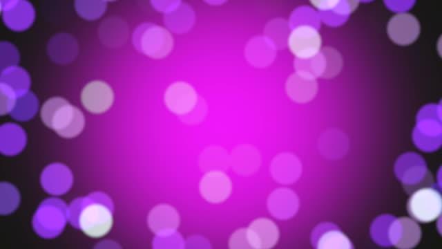 Magenta- und rosafarbener Partikel floating in Zeitlupe. Endlos wiederholbar Filmmaterial.