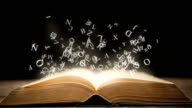 Magic book with animation glowing letters