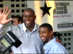 Magic Johnson and his son Andre Johnson at the 'King's Ransom' Los Angeles Premiere at the Cinerama Dome at ArcLight Cinemas in Hollywood California...