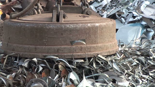 MS POV Magnet lifting steel scrap at scrapyard / Bous, Saarland, Germany