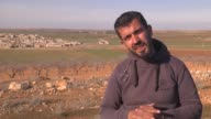 Mahmoud Halu Abu Hamza a commander of the FSA's Ahfad Salahaddin Brigade speaks during an exclusive interview in AlBab Syria on February 22 2017 The...