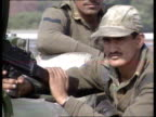 Delhi LMS Mounted troops along PAN LR LS Car along Premier John Major out of car and shakes with Indian Premier Narasimha Rao MS SIDE row of troops...