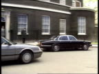 Major's Speech ENGLAND London Downing St LMS PM John Major MP wife Norma and others out of No 10 and into car ZOOM IN MS Cars away from No 10 PAN LR...