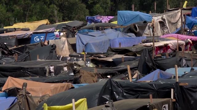 A makeshift campsite near Sao Paulo sheltering thousands of Brazilian families illustrates the country's housing crisis which in 2015 carried a...