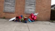A makeshift memorial rests against the wall of an apartment building near the location where a 24yearold man was shot and killed on May 4 2015 in...