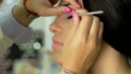 Make-up artist applying eyeliner