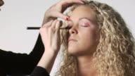 makeup artist applying makeup to a woman