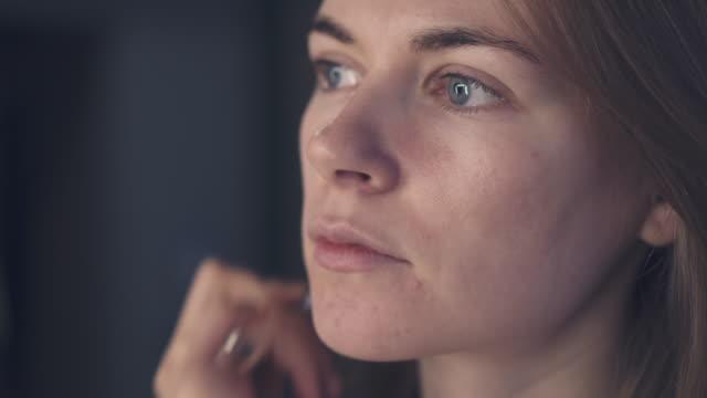 Makeup artist applying tone on model face