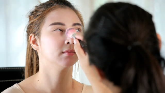 Makeup artist applying
