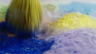 Makeup brush abstract backgrounds slow motion beauty colorful powder