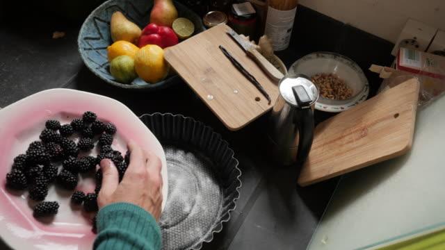Making a blackberry clafoutis: adding blackberries