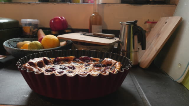 Making a blackberry clafoutis: cooling down
