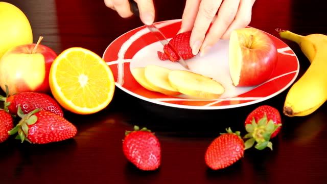 Making fruit salad.