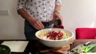 Making kimchi: adding Korean pepper to the vegetables