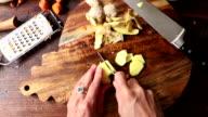Making kimchi: chopping ginger