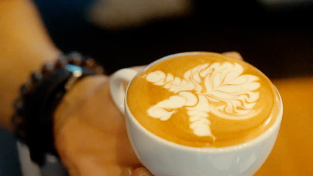 Making of latte art, Milk pouring by a Barista.