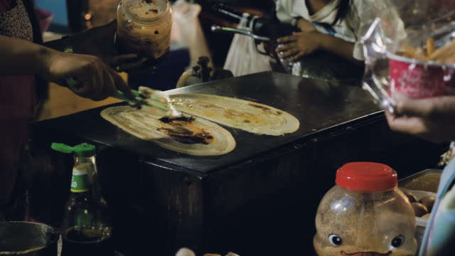 Making pancakes at open-air food festival.