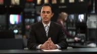 MS Male anchor speaking at news desk, Dallas, Texas, USA