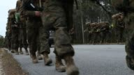 Male and female Marines head out for a 10 kilometer hike carrying 55 pound packs at Marine Combat Training on February 22 2013 at Camp Lejeune North...