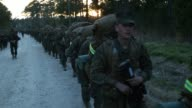 Male and female Marines head out for a 15 kilometer night hike carrying 55 pound packs at Marine Combat Training on February 21 2013 at Camp Lejeune...