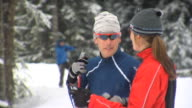 MS Male and female skier talking, Whistler, British Columbia, Canada