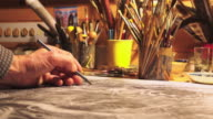 Male artist's hand sketching something