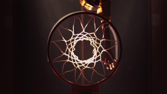 HA CU Male Basketball Player slam dunking