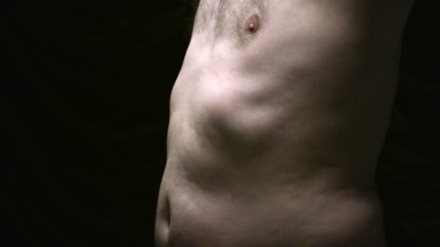 (HD1080i) Male Body Issues: Torso, Stomach, Ribs, Chest in Light